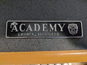 Academy Ford dealer emblem